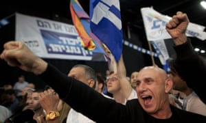 Supporters of Binyamin Netanyahu celebrate as election results come in at his election campaign headquarters. However, it's not yet clear whether he has won.