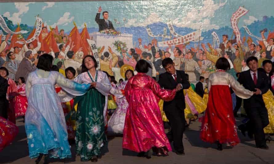 North Koreans dance