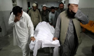 Relatives move the body of Samiullah Afridi, who was killed by unidentified gunmen, at a hospital in Peshawar. Afridi was the former defence lawyer for  Shakil Afridi who had been jailed after helping the CIA find al-Qaida chief Osama Bin Laden.