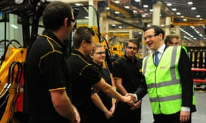 George Osborne meets apprentices during a visit to a JCB factory