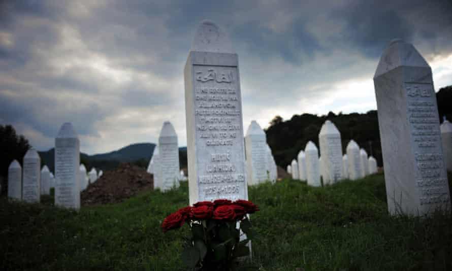 Flowers are seen at a grave in the Potocari memorial cemetery near Srebrenica.