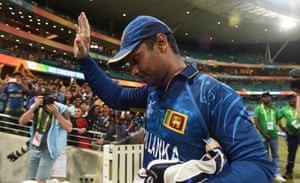 Sri Lanka's cricketer Kumar Sangakkara waves to the crowd as he leaves the pitch after the match.