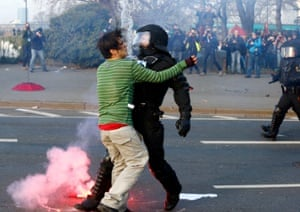A policeman clashes with a Blockupy anti-capitalist protester