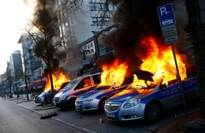 Four German police cars set on fire by anti-capitalist protesters burn near the European Central Bank building