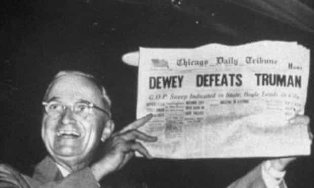 Newly re-elected President Harry Truman gleefully displaying a copy of the Chicago Daily Tribune newspaper with inaccurate early edition headline.