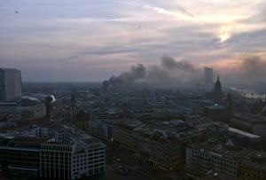 Smoke engulfs the city skyline during a protest of members of 'Blockupy' anti-capitalist movement near the European Central Bank (ECB) building