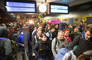 Activists arrive in Frankfurt am Main station for the protest