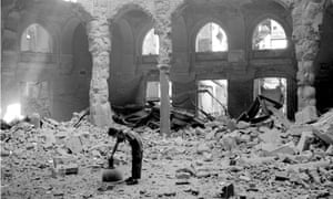 Woman in the destroyed National Library hall after shelling in Sarajevo on August 26, 1992