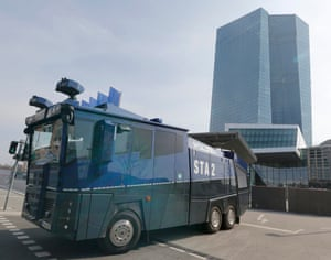 A police vehicle is parked near the European Central Bank building