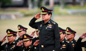 Eyes right: General Prayuth Chan-ocha at a military ceremony. Disagreeing with his path, he has declared, is incompatible with the very nature of 'Thainess'.