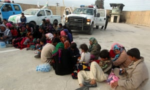 Displaced Sunni families at an army camp in Samarra after fleeing villages because of fighting