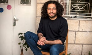 Amer Shomali photographed outside his studio in Ramallah by Tanya Habjouqa for the Observer