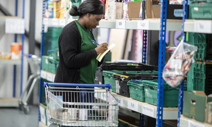 A volunteer prepares parcels at a Trussell Trust food bank in Birmingham.