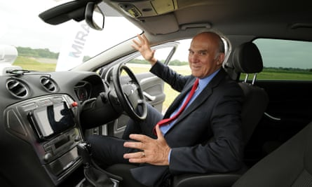 Vince Cable  sits in a driverless car at the headquarters of motor industry research organisation Mira, in Nuneaton.