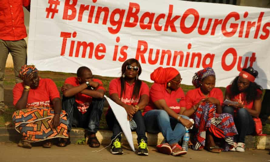 Members of an Abuja protest group wield a banner bearing the #BringBackOurGirls slogan in support of the schoolgirls kidnapped in Nigeria last April. Online hashtag activism can play a key role in supporting women's rights.