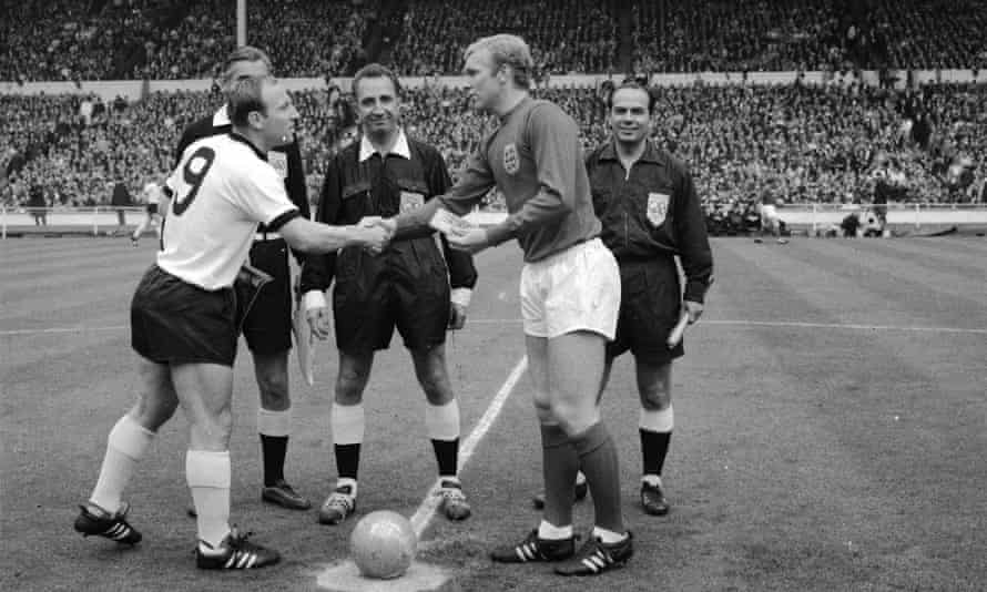 German captain Uwe Seeler shakes hands with England captain Bobby Moore
