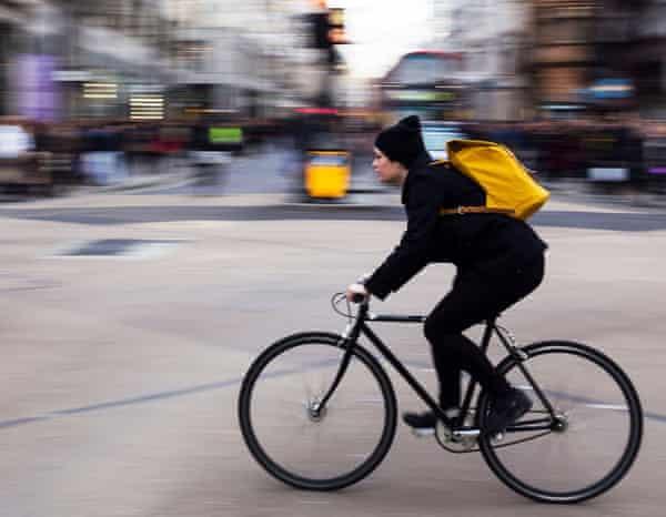 Cycling across Oxford Circus.