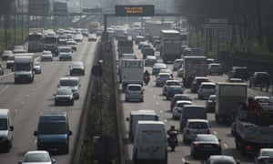 A picture shows cars on the parisian betltway on March 18, 2015 in Paris, as the French capital is experciencing a pollution peak.