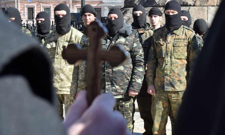 A priest blesses fighters of the Ukrainian Donbass volunteer battalion