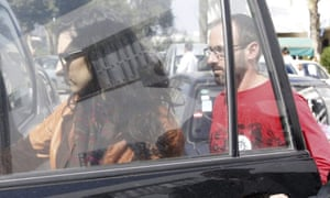 Cristina Rubio and Juan Carlos Sanchez leave the Charles Nicole hospital in Tunis