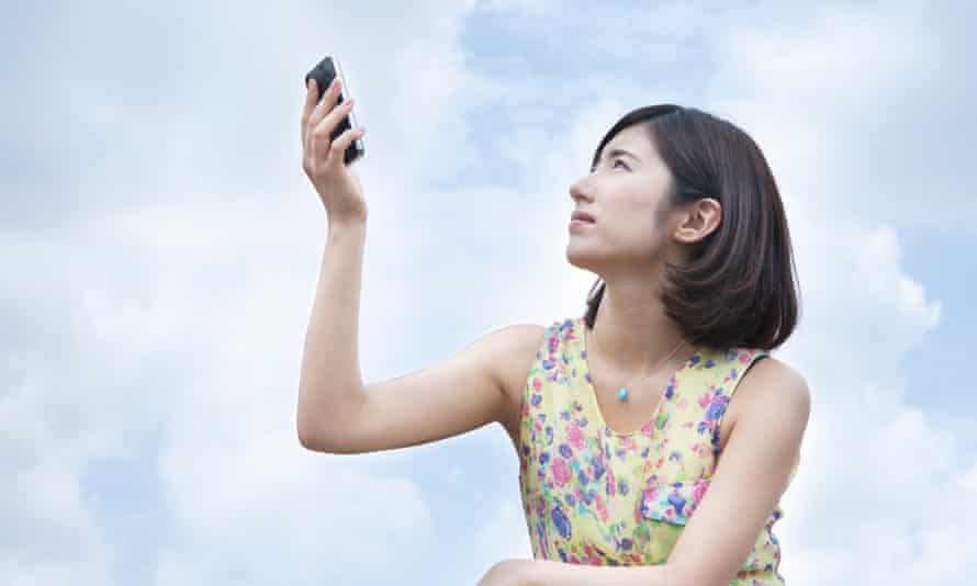 A young woman holding smartphone