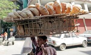 Boy selling bread in Cairo
