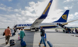 Passengers board a Ryanair flight. Monday's announcement heralded Ryanair flights between European and US cities, including New York, Boston, Chicago and Miami from London Stansted, Dublin and Berlin.