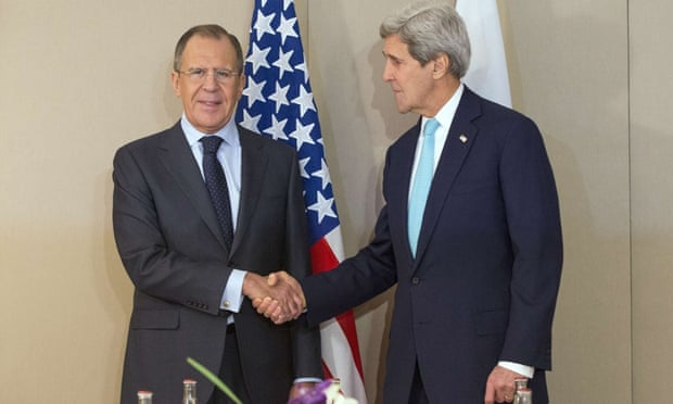 John Kerry (right) shakes hand with Sergei Lavrov prior to the Geneva talks.