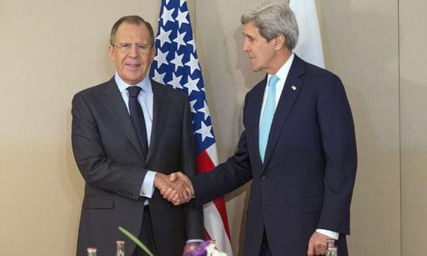 John Kerry (right) shakes hand with Sergei Lavrov prior to the Geneva talks.