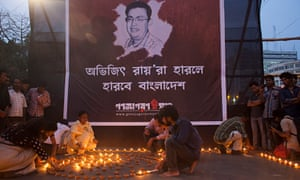 Activists light lamps in protest against the killing of Avijit Roy in Dhaka, Bangladesh