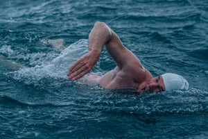 Lewis Pugh swimming at Bay of Whales, Antarctica as part of his 5 Swims expedition