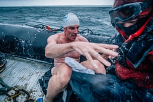 Antarctica Lewis Pugh, the British endurance swimmer and United Nation's Environment Programme Patron of the Oceans, swimming at Bay of Whales, Antarctica as part of his 5 Swims expedition. See more images here