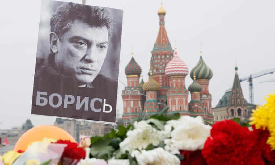 A portrait of murdered Russian opposition veteran leader Boris Nemtsov above floral tributes near St Basil's cathedral in Moscow