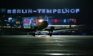 Minutes before midnight a DC-3 airplane, also named 'Candy Bomber', takes off the last time from the Tempelhof airport in Berlin  on Thursday, Oct. 30, 2008. At midnight the airport will be closed for air traffic after 85 years of service. (AP Photo Markus Schreiber)