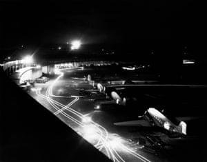A line of U.S. Air Force C-47 transport planes unload milk to waiting trucks during the Berlin Airlift. --- Image by   CORBISAircraftAirplanesAirportBerlinBerlin Airlift, 1948-1949BlurCargo aircraftCitiesCold War, 1945-1991Douglas Aircraft Corporation aircraftDouglas C-47 SkytrainEuropeEuropean historical eventGerman historical eventsGermanyHistoric eventsLight trailsMilitary airbasesMilitary aircraftMilitary basesMotion blurMotor vehicleNightNobodyPropeller airplaneTarmacsTempelhof AirfieldTime exposure photographyTransportationTruckVehicle