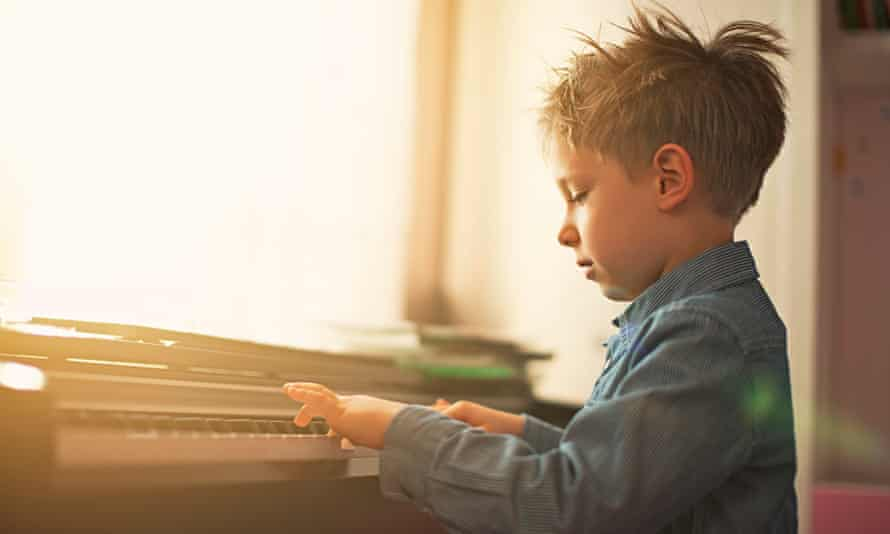 small child playing the piano