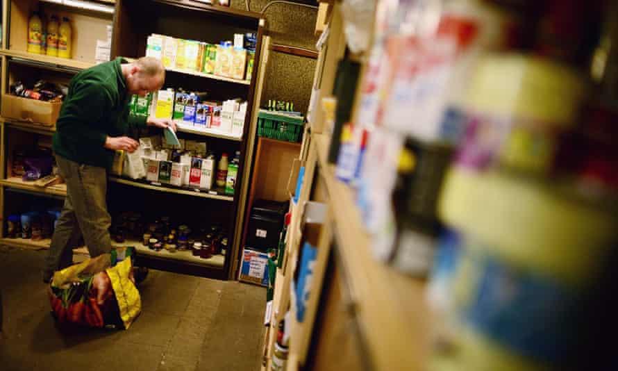 A volunteer packs food at a food bank