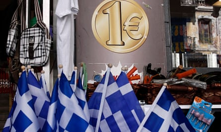 Greek national flags are displayed for sale at the entrance of a one euro shop in Athens