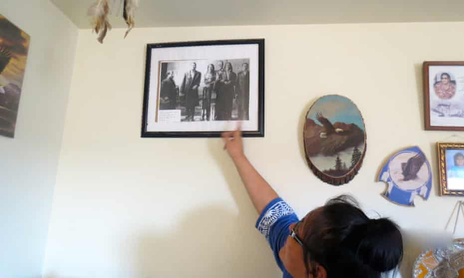 Janice at home, showing family pictures.
