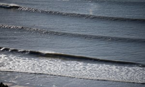 """Langland Bay, Swansea, Wales, UK. 4th November 2013. """" Surfers making the most of the sunny weather and swell at Langland Bay near Swansea this morning."""
