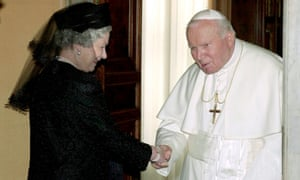 The Queen shakes hands with Pope John Paul II at the Vatican in Rome.