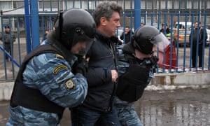 Russian riot policemen detaining Nemtsov