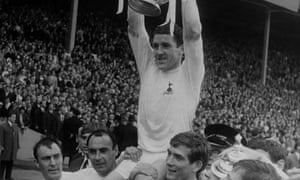 Dave Mackay, the captain of Tottenham Hotspur, celebrating after winning the FA Cup in 1967