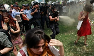Turkish riot policeman uses tear gas against protesters