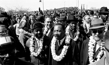 Martin Luther King leads the march across the Edmund Pettus Bridge in Selma, 21 March 1965