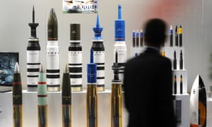 A man looks at tank ammunition at the Defence and Security Equipment International (DSEI) arms fair at the ExCeL centre in east London, on September 10, 2013. The arms fair describes it self as the world's largest fully integrated defence and security exhibition.