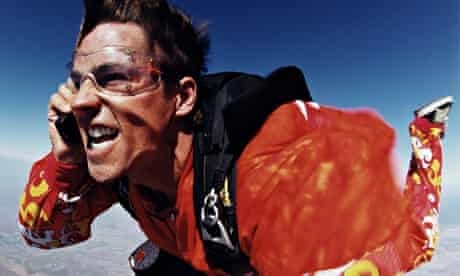 Man skydiving while on the phone