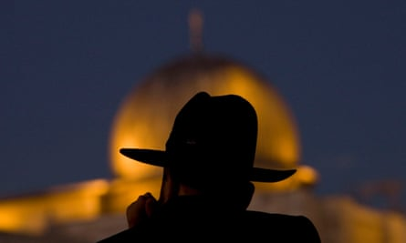 An ultra Orthodox Jewish man pauses in sight of the al-Aqsa mosque, which is in the Haram al-Sharif/Temple Mount complex.