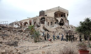 Syrian government forces sift through rubble after a huge explosion in the Carlton Citadel hotel in 2014.