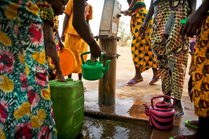 Children queue to collect clean water in the Malian village of Diatoula, 15km outside of Bamako, which has more than 1,000 inhabitants. As many as 4.9 million people, more than a third of the population, lack safe water. The situation for sanitation is worse at 75%